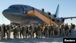 Canadian Armed Forces members from 4 Wing Cold Lake, Alberta, depart for their deployment, Oct. 22, 2014.