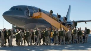 FILE - Canadian Armed Forces members from 4 Wing Cold Lake, Alberta, depart for their deployment, Oct. 22, 2014. Canada will end its airstrikes against Islamic State targets in Iraq and Syria this month.