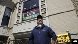 FILE - In this June 14, 2020, file photo, James Juanillo poses outside of his home in San Francisco. (AP Photo/Jeff Chiu, File)