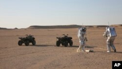 Scientists test space suits and a geo-radar for use in a future Mars mission in the Dhofar desert of southern Oman, Feb. 7, 2018..