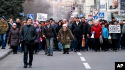 Demonstrators march during a pro Russia rally in Donetsk, Ukraine, March 11, 2014