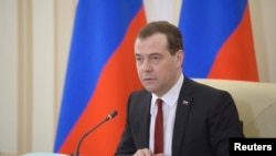 Russia's Prime Minister Dmitry Medvedev chairs a government meeting in the Crimean city of Simferopol, March 31, 2014. Russia will make Crimea a special economic zone offering tax breaks and reduced bureaucracy to attract investors, Prime Minister Dmitry