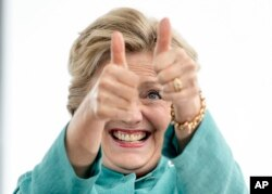 Democratic presidential candidate Hillary Clinton gives two thumbs up as she takes the stage to speak at a rally at C.B. Smith Park in Pembroke Pines, Fla., Nov. 5, 2016.
