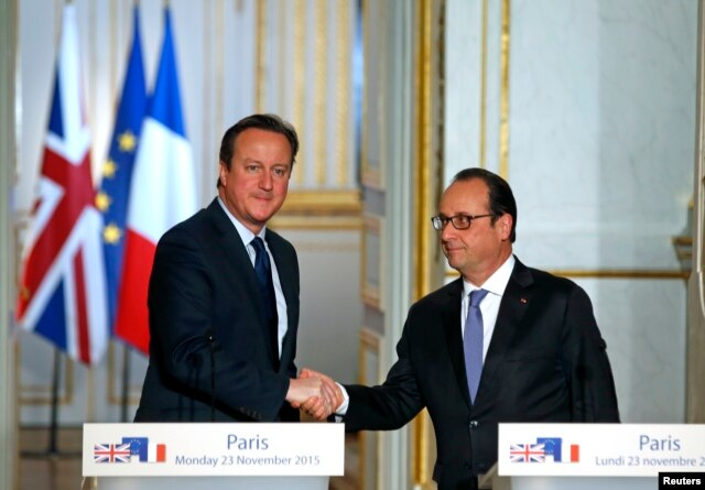 FILE - French President Francois Hollande (R) shakes hands with Britain's Prime Minister David Cameron during a joint news conference Nov. 23, 2015, at the Elysee Palace in Paris.