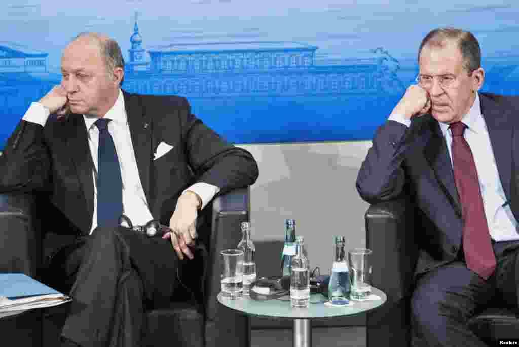 French Foreign Minister Laurent Fabius (L) and Russian Foreign Minister Sergey Lavrov attend the Munich Security Conference at the Bayerischer Hof Hotel in Munich, Germany.