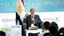 "FILE - In this Nov. 7, 2017 photo, Egyptian President Abdel-Fattah el-Sissi participates in a meeting with a group of young people at the ""World Youth Forum,"" a government-organized event in Sharm el-Sheikh, Egypt."