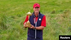 Team USA captain Steve Stricker poses with Ryder Cup after the United State beat Europe for the 43rd Ryder Cup golf competition at Whistling Straits, Sep 26, 2021.