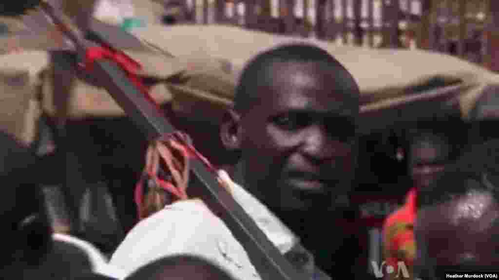 A member of the Civilian JTF with a homemade weapon in Maiduguri, Nigeria, December 2013. (Heather Murdock for VOA)