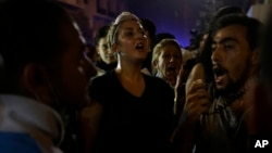 Lebanese anti-government demonstrators shout slogans during a protest against the ongoing trash crisis and government corruption in Beirut, Sept. 9, 2015.