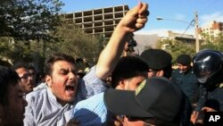 An Iranian protester chants slogans at the Saudi Arabian Embassy in Tehran, Iran, on Sept. 27, 2015, during a gathering to blame Saudi for a deadly stampede that killed at least 700 and possibly 1,400 people.