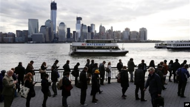 A long line forms at the ferry terminal in Jersey City, N.J., as people commute toward New York City, November 5, 2012. Flooding caused by Superstorm Sandy halted mass transportation in the northern New Jersey region, with train service to New York comple
