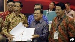 Indonesia President-elect Joko Widodo, left, and his running mate Jusuf Kalla, center.