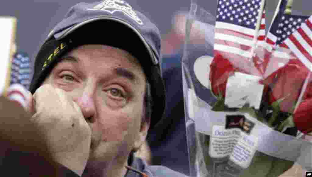 Richard Dell, of Altoona, Pa., wipes away joyful tears as he watches the return of the USS Stennis, with his sailor daughter Chelsea Dell aboard, to Naval Base Kitsap Bremerton, Friday, March 2, 2012, in Bremerton, Wash. The Stennis completed a seven-mont