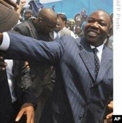 Gabon President Ali Ben Bongo Ondimba greets supporters (file photo)