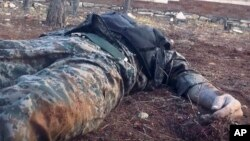 This image posted online by the Ahrar al-Sham militant group purports to show a dead Syrian soldier in a government-held neighborhood of Aleppo, Syria. The Syrian military has reportedly called in reinforcements for a rebel counteroffensive in the city.