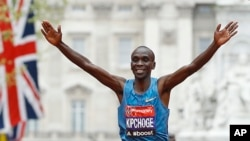 FILE - Eliud Kipchoge of Kenya wins the men's race in the 35th London Marathon, April 26, 2015. He also won the race the following year.