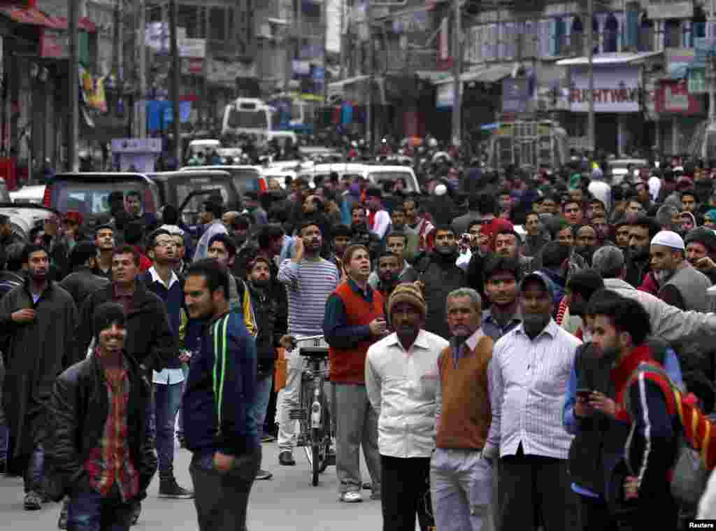 People rush into the streets, vacating buildings following a powerful earthquake in Srinagar, Kashmir, Oct. 26, 2015.