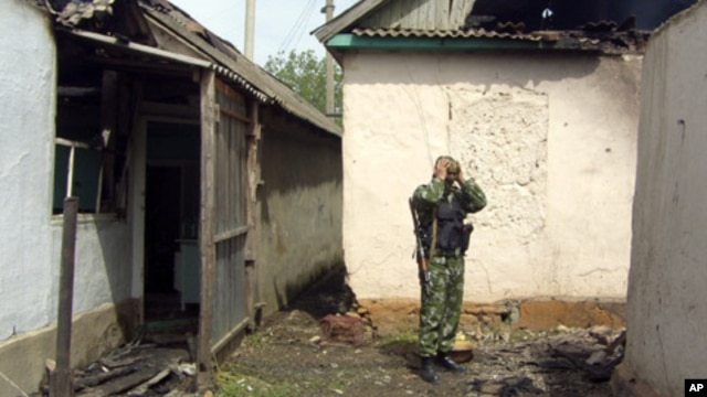 A Russian special forces trooper stands amidst the rubble following a major police operation in Khasavyurt, Dagestan, near the border with Chechnya (file photo)