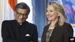 Secretary of State Hillary Rodham Clinton shakes hands with Indian Foreign Minister S.M. Krishna at the State Department in Washington, Wednesday, June 13, 2012.