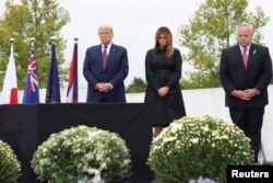 U.S. President Donald Trump and first lady Melania Trump are accompanied by U.S. Secretary of the Interior David Bernhardt as they attend a ceremony at the Flight 93 National Memorial, remembering those killed when hijacked Flight 93 crashed into an open field on September 11, 2001, in Stoystown, Pennsylvania, September 11, 2020. REUTERS/Jonathan Ernst