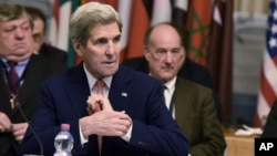 U.S. Secretary of State John Kerry takes part in an international conference on Libya, at the Ministry of Foreign Affairs in Rome, Dec. 13, 2015.