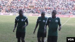 FILE: Referees Thomas Kusosa, left, Munyaradzi Majoni, centre, and Edgar Rumeck, right, warm up before a clash between bitter rivals, Highlanders and Dynamos at BF.