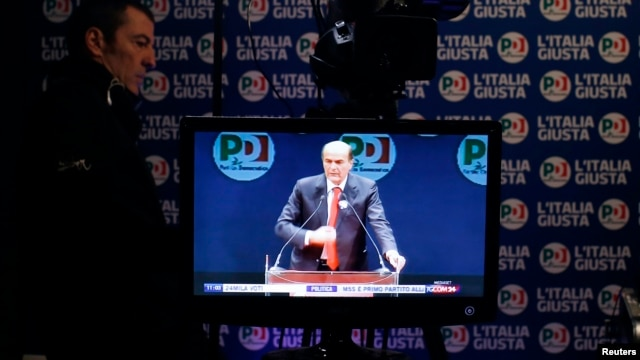 A television screen shows Democratic Party leader Pierluigi Bersani at a media center in Rome, February 26, 2013.