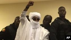 Chad's former dictator Hissene Habre raises his hand during court proceedings in Dakar, Senegal, May 30, 2016.