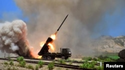 FILE - A view of a multiple rocket launcher during an exercise in this undated photo released by North Korea's Korean Central News Agency (KCNA) in Pyongyang.