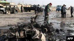 Iraqi security forces inspect the scene of a car bomb attack in Ramadi, 70 miles (115 kilometers) west of Baghdad, Iraq, 12 Dec 2010