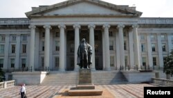 A man walks away from the U.S Treasury Department in Washington, U.S