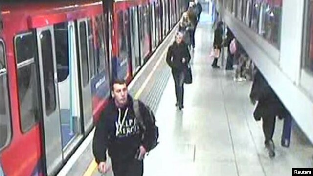 In this CCTV image released by the London Metropolitan Police, showing Lee Rigby of the Royal Regiment of Fusiliers (L), in this photo dated May 22, 2013, at Woolwich DLR rail station in London.