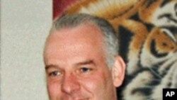 Doanh nhân người Anh Neil Heywood tại một phòng trưng bày tranh ở Bắc Kinh tháng 4 năm 2011