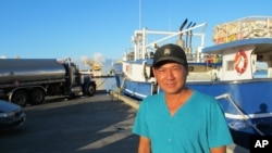 FILE - In this July 20, 2015 photo, fishing boat captain Hoai Dang poses for a photo in Honolulu Harbor.