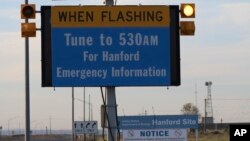 An emergency sign flashes by the Hanford Nuclear Reservation, May 9, 2017, in Richland, Wash. A portion of an underground tunnel containing rail cars filled with radioactive waste collapsed at a sprawling storage facility in a remote area of Washington state, forcing an evacuation of some workers at the site.