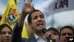 Venezuela's self-declared interim leader Juan Guaido speaks to supporters in a public plaza in Las Mercedes neighborhood of Caracas, Venezuela, Jan. 26, 2019.
