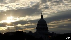 The Sun rising over the U.S. Capitol, Washington, D.C. (undated file photo).