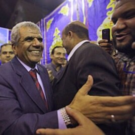 Sobhi Saleh (l), a senior member of the Muslim Brotherhood and former member of parliament, is surrounded by supporters in Cairo, Egypt, May 12, 2011