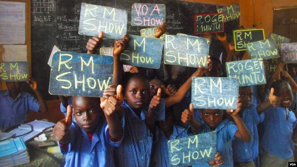"Adoring fans of Roger Muntu's ""RM Show"" take a break from school to pose for photos in Lome, Togo. The ""RM Show,"" part of VOA's French to Africa Service, is a sociocultural music program that airs daily from 4 - 4:30 p.m."