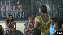 Michelle Obama spoke to school girls and women during her visit to Liberia last summer. Seated next to her is Liberian President Ellen Johnson Sirleaf. (Credit: )