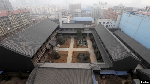 FILE - An unfinished residence which belongs to former People's Liberation Army (PLA) General Gu Junshan is pictured in Puyang, Henan province, January 19, 2014.