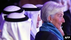 IMF chief Christine Lagarde, right, attends an international conference on Islamic finance, in Kuwait City, Nov. 11, 2015. She has urged Gulf countries, hurt by falling oil prices, to consider scaling back subsidies and levying taxes.