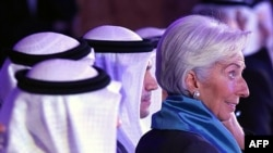 The head of the International Monetary Fund, Christine Lagarde, right, attends an international conference on Islamic finance, in Kuwait City, Nov. 11, 2015.