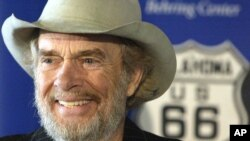 FILE - Merle Haggard smiles during a news conference at the Smithsonian's National Museum of American History in Washington, where he and his sister donated belongings taken on their family's Dust Bowl-era move to California on Route 66, May 28, 2003.
