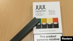 FILE - A Juul e-cigarette starter pack is seen July 16, 2018.