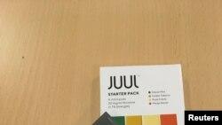 FILE - A Juul e-cigarette starter pack is seen July 16, 2018.