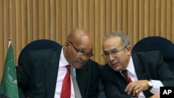 S. African President and Chairperson of the AU Committee on Libya, Jacob Zuma, left, talks with Ramtane Lamamra, African Union Commissioner for Peace and Security in Addis Ababa, Ethiopia, August 26, 2011 during a conference on Libya.