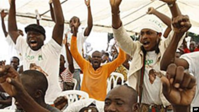 Supporters of opposition leader Alassane Ouattara, make their feelings known, as they sing at an event at a hotel in Abidjan, Ivory Coast, 30 Dec 2010