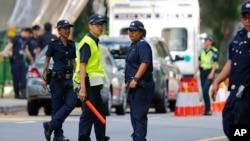 ماموران امنیتی سنگاپور در محل تیراندازی