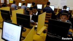 FILE - Students use computers to study at a secondary school in Cape Town, South Africa, Nov. 7, 2013. The World Bank estimates that 70 percent of Africans leave school without the basic skills they need to compete.